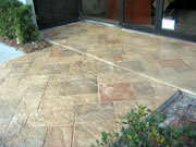 concrete walkway with stamped stone pattern